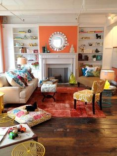 This is what I want my living room to look like! A BUNCH of colors and bright accents :)