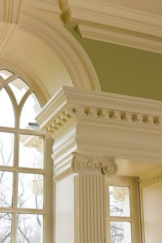 luxurious classical architecture. arch window, dentil moulding, Ionic columns, lime walls, cream trim,beautiful in hot locations