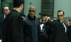 Neo and Morpheus meet a replica of Agent Smith in the training program The Wachowskis, Agent Smith, The Matrix Movie, Matrix Reloaded, Carrie Anne Moss, Hugo Weaving, Val Kilmer, Action Film, Great Films