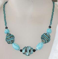 Dramatic Turquoise bead necklace by mizmlu on Etsy, $34.97! Yum!