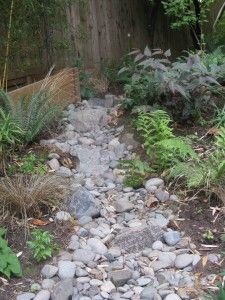 Controlling too much water with a dry bed.No tutorial but a great idea for our wet problem spot. Add a rain garden and it works