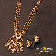 Look more gorgeous with this gold long necklace with it's matching earring studded with Cubic Zircone stone and small south sea pearls. Indian Gold Jewellery Design, Gold Bangles Design, Diamond Jewellery, Bridal Jewellery, Necklace Set, Gold Necklace, Mom Jewelry, Antique Necklace, Necklace Online