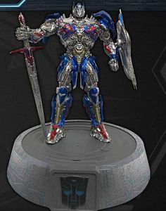 *PRE-ORDER* TRANSFORMERS: The Last Knight Optimus Prime Phone Dock Statue BY Swordfish USA Corporation