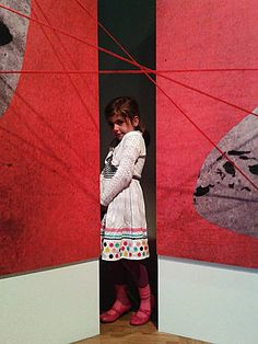 A little girl in the middle of my artistic installation.