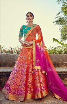 Price @7725.00 INR Colour : Orange, Pink & Turquise Top : Banglori Silk Lehenga : Banarasi Silk Dupatta : Net Work : Heavy Embroidery