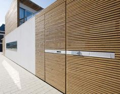 [Wood and white Facade by Pasel Kuenzel Architects