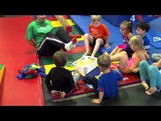 V-sit drill lifting bean bags into a bucket with feet for PreK Gymnastics Kids Gymnastics Games, Gymnastics Academy, Preschool Gymnastics, Gymnastics Videos, Gymnastics Coaching, Gymnastics Training, Gymnastics Workout, Crossfit Kids