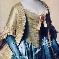 The drama of this 1760s ensemble is such that it feels as if it were a TV or film costume, giving a contemporary twist to the 18thc. It is in fact all original, cream satin caraco, silk laced stays & contrasting petticoat all in the Kyoto Costume Institute #kyoto #costumeinstitute #dresshistory #fashionhistory #18thcentury #18thcenturyfashion #1760s #mid18thcentury #stays #caraco #silkpetticoat #petticoat #corset #handsewn #madebyhand