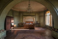 This looks like the master bedroom inside an abandoned chateau. But since there are 9 bedrooms inside it's a bit of a guess.