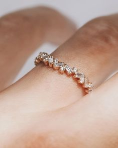Our new arched ring, a baguette diamond cluster, is a beautiful addition to any stack!