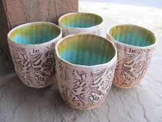 Ceramic Porcelain Tumblers Wheel Thrown Textured Aqua Blue Glaze Yellowstone Paint Pot Series. $25.00, via Etsy.