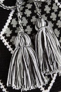 Hand-woven Black, white and pale-green cotton Shoulder strap Designer-stamped wooden disc Tasseled drawstring fastening at top Designer color: Black/ White/ Gray Each bag is handmade and totally unique. Product may differ from that pictured