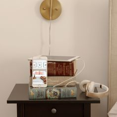 A book stack becomes a charging station with these handy DIY.