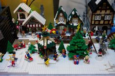 Lego Christmas Village by Rob Bender, via Flickr . I like how they did the sidewalks and layered the legos for the snow