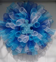 Light It Up Blue Wreath for Autism Awareness Month. Created by Sweet Daisy Lane and found on Facebook.