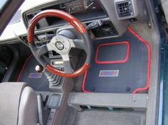 A20 TBO sporting wood Momo steering wheel and special Turbo 505 floor mats I had commissioned for the MG Car Club FWD register. I think the drivers seat was missing to show off the mats. Leather seats from a Rover 420 GSi were later fitted to this car when I owned it.