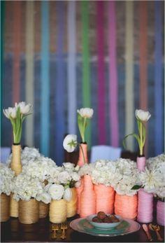 flowers in yarn wrapped vases