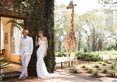 Mason would love if we could have our wedding picture taken near a giraffe!