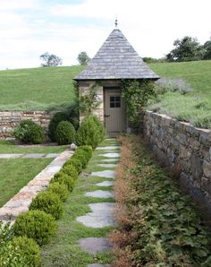 tucked into the hillside and in a corner of the walled garden...just beautiful!