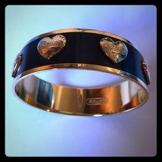 Coach Bracelet Gold and With black enamel Coach bracelet. Gold hearts on black enamel with signature Coach name on each. Coach Jewelry Bracelets