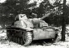 Winter camouflage and clothing can make it difficult to identify the unit in this photo. Still, this Sturmgeschütz III Ausf.G with the Sa...