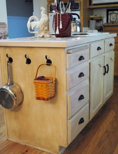 I refinished my kitchen island cabinets using Rust-Oleum's Cabinet Transformation Kit - and I am fairly happy with the results!