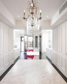 Luxurious Carrara marble dressing room with a fabulous pink chair. Marble Floor, Carrara Marble, Girls Dream Closet, Dressing Room, Interior Design, Luxury Interior, Sweet Home, Chandelier, Ceiling Lights