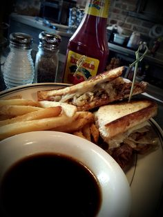 Introducing the Short Rib Grilled Cheese - slow roasted boneless beef short rib, caramelized onion, Gruyère & cheddar on grilled sourdough with au jus on the side. Only at #StandardDiner in Albuquerque, NM