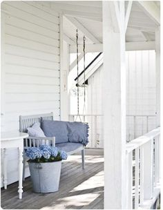 Simply blue & white- coastal porch perfection.