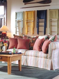 WALL ART THAT POPS  -- SPARE SEATING  --  Tired household objects get a new lease on life when used as art. Check out these multi-colored folding chairs.