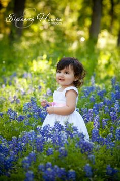 Adorable little girl in the Texas Bluebonnets photographed by Master Photographer Elizabeth Homan out of San Antonio, Texas. www.portraitsbyelizabeth.com #bluebonnets #sanantonio #artisticimages