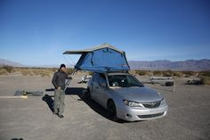 Nice example of Compact Car Camping with a roof top tent equipped Subaru in Death Valley. Photo by Jennifer Weiss
