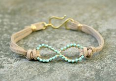 Turquoise Infinity Bracelet Wire Wrapped Gold Brass and Suede MADE TO ORDER. $20.00, via Etsy.