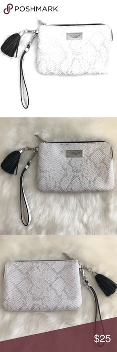 "🐰Victoria Secret Silver and White Wristlet 🐰 👑• All reasonable offers accepted only through ""offer"" button, NO lowballs please  👑• Bundle 3 or more items from this closet for an additional 10% off!  👑• No modeling, holds or trades! Sorry for the inconvenience  👑• All items are from a smoke free home  👑• New listings added weekly, make sure to check back often! I carry various sizes/brands ❤️Thank you for shopping my closet❤️                •Happy Poshing• Victoria's Secret Bags…"