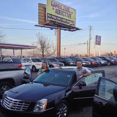 Sean and his wife with their Cadillac