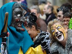 Masked participants take part at the carnival parade in Zurich, Switzerland.