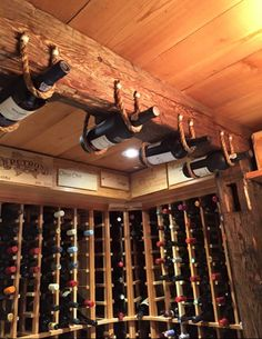 Old World Hanging Bottle Display with Wine Crate Panel Backsplash - Buy Wine Panels for a Similar Project at Winepine Spiral Wine Cellar, Wine Cellar Basement, Home Wine Cellars, Wine Cellar Design, Wine House, Bottle Display, Man Cave Home Bar, In Vino Veritas, Italian Wine