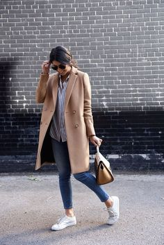 Kayla Seah rocks this double breasted camel jacket. Coat: Sezane, Blouse: The Kooples, Jeans: Acne, Sneakers: Common Projects, Bag: Celine, Bracelet: Jenny Bird. camel coat outfit classy