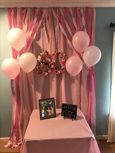 Plastic table cloths with streamers make a great backdrop for birthday tables and photo ops