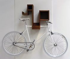 space-saving bike storage ideas for small apartments. Indoor bike storage solutions are for people who can't part with their bicycle. Indoor Bike Storage, Indoor Bike Rack, Bicycle Storage, Bicycle Rack, Bike Hooks, Bike Hanger, Bike Shelf, Small Space Living, Small Spaces