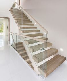 Amazing Sleek Modern Glass Railing Stair Design Ideas 17 - Awesome Indoor & Outdoor Source by bertra Glass Stairs Design, Wooden Staircase Design, Rustic Stairs, Wooden Staircases, Glass Railing, Railing Design, Stair Design, Railing Ideas, Staircase Ideas