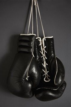 Boxing Gloves Hanging on a Wall.: