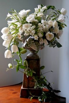 Stunning tulip arrangement. White Magnolia Floral Designs. Photo by Holly Chapple Flowers - http://thefullbouquetblog.com/