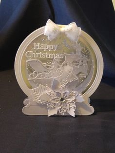 Tattered Lace Snow Globe die with santa sleigh, reindeer and poinsettia