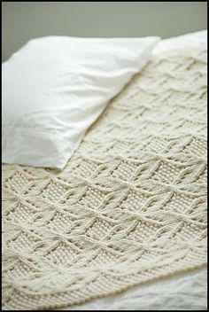 A luxuriously textured wool throw, worked in super-bulky yarn. A smooth, round yarn is recommended for best results with stitch definition. The fabrics motif is created through the use of lace, cables and knit-purl patterning. Knitted Afghans, Knitted Baby Blankets, Stitch Patterns, Knitting Patterns, Crochet Patterns, Knitting Stitches, Baby Knitting, Laine Drops, Brooklyn Tweed