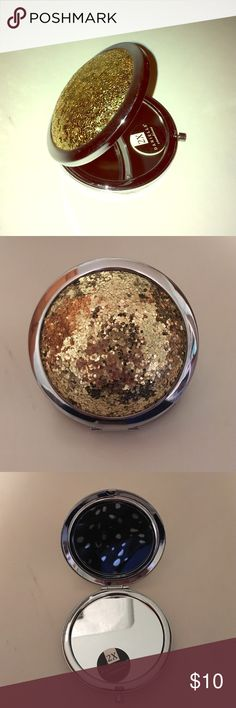 Gold Sparkly Travel Mirror Description: Still in box! Great travel mirror!   Condition: New! Smoke free home! Ask questions before you purchase! Accessories