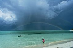 Rainbow over the sea islands of UNOCI, the Philippines, taken by George Tapan, is the winner for places for National Geographic