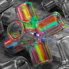 Close up of a tube cross joint made of iridescent glass, resting on a plank floor. 2020, giclée print. Watermarked preview. #glassart #iridescent #iridescence #coloredglass #crossjoint #tubecross #glass #artofglass #vibrantcolors #colorful #polychromatic #shimmering #colorspectrum #refractionoflight #lightrefraction #refractive #glasstubes #glasspipes #colours #colors Vibrant Colors, Colorful, Colours, Refraction Of Light, Flora Und Fauna, Art Of Glass, Glass Pipes, Colored Glass, Plank