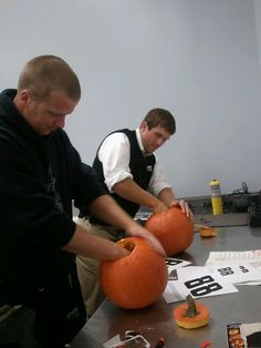 No. 88 rear-tire carrier Matt Ver Meer (left) and No. 88 front-tire carrier Kevin Harris (right) decided to join in the fun by carving their own Hendrick Motorsports-themed pumpkins to help remind fans to do the same.