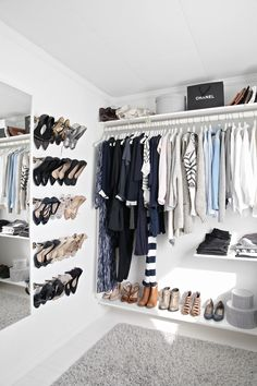 A Crisp and clean closet, yes please!  Love the idea of the towel bars for my heels! Now I just need a walk-in closet with this must space and light.